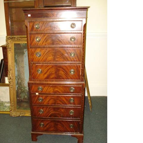 A reproduction George III style mahogany tallboy chest, fitted with eight drawers, on bracket feet, 63cm.