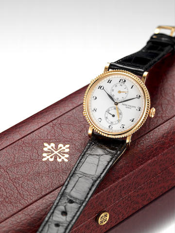 Patek Philippe. A fine 18ct gold two time zone wristwatch with Patek Philippe fitted boxTravel Time, Movement No.3079964 Ref:5034