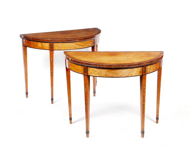 A pair of George III satinwood and rosewood, crossbanded, demi-lune fold-over card tables