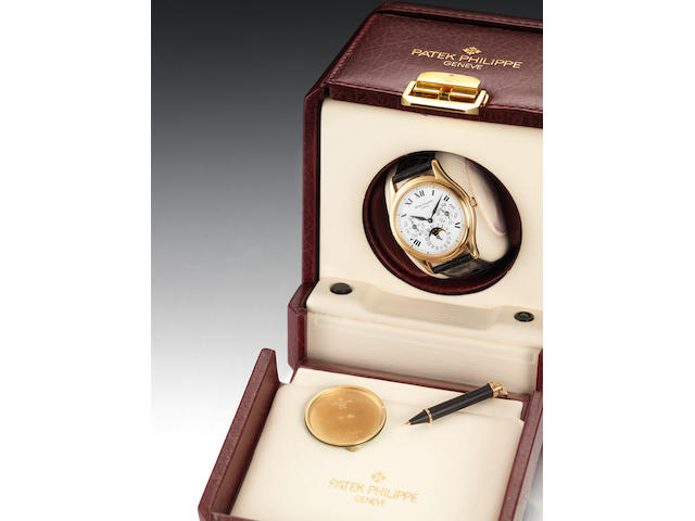 Patek Philippe. A fine 18ct gold automatic perpetual calendar wristwatch with phases of the moon together with Patek Philippe automatic winding boxRef:3940, Case No.4125894, Movement No.3125084, Made in 1999, Sold 6th December 2000