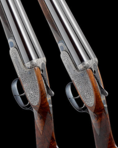 A fine pair of Kell-engraved 12-bore self-opening sidelock ejector guns by J. Purdey & Sons, no. 25256/7 In their leather motor-case, together with another leather motor-case with J. Purdey trade-label