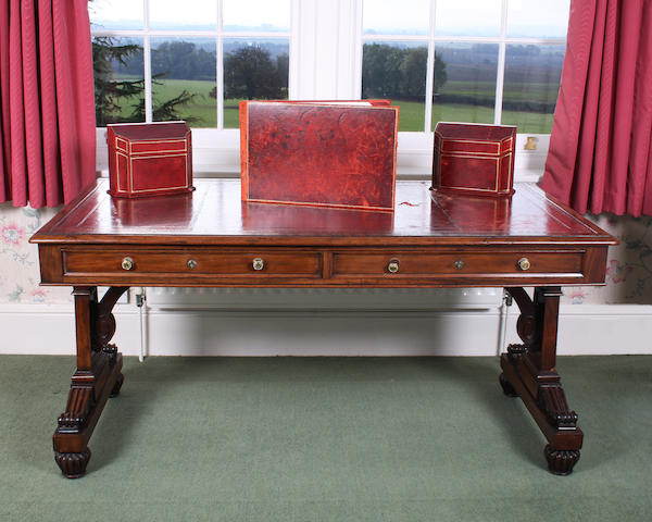 A William IV classical design mahogany library writing table