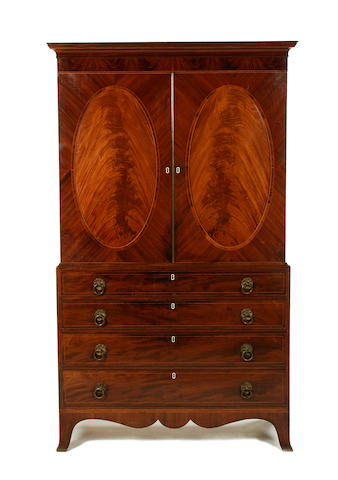 A Regency mahogany and rosewood crossbanded linen press
