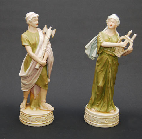 A pair of Royal Dux figure