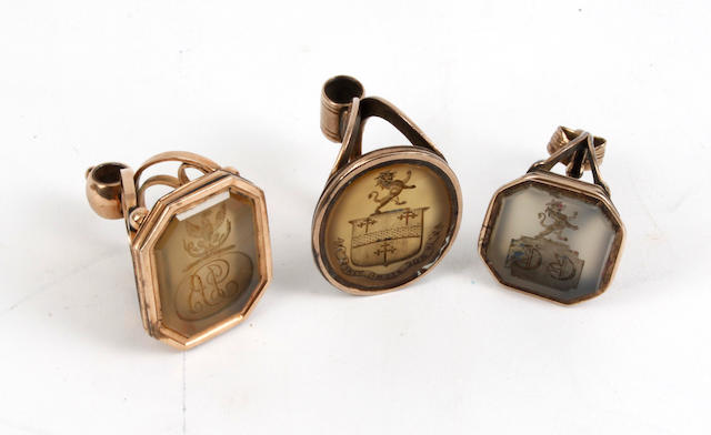Three early 19th Century gilt metal and hardstone fob seals.