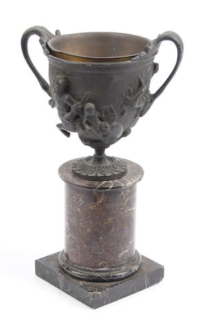 A small classical twin handled bronze vase
