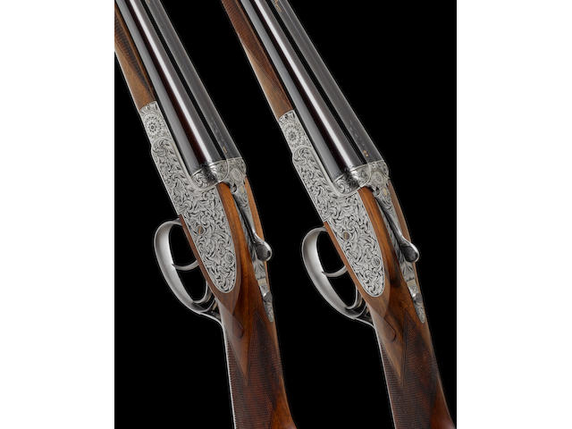 A fine pair of Portsmouth-engraved .410 (3in) self-opening sidelock ejector guns by Asprey, no. 1523/4 In their brass-mounted oak and leather case with makers accessories