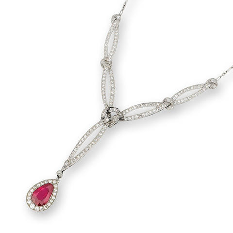 A ruby and diamond pendant/necklace and ring combination, (2)