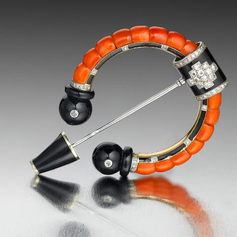 A fine art deco onyx, coral, enamel and diamond penannular brooch, by Cartier,