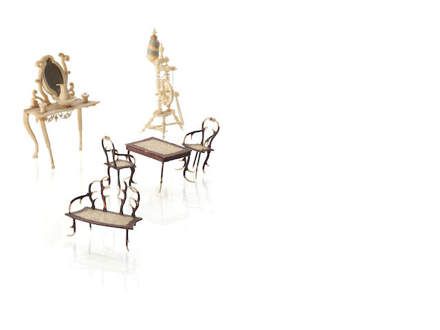 A selection of Victorian miniature ivory furniture