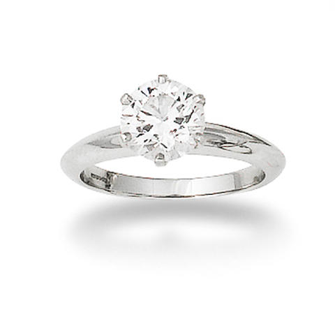 A diamond single-stone ring,  by Tiffany