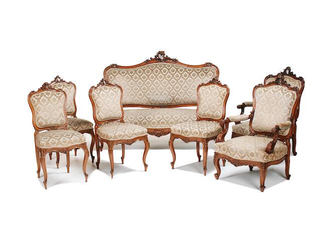 A German third quarter 19th century carved walnut salon suite