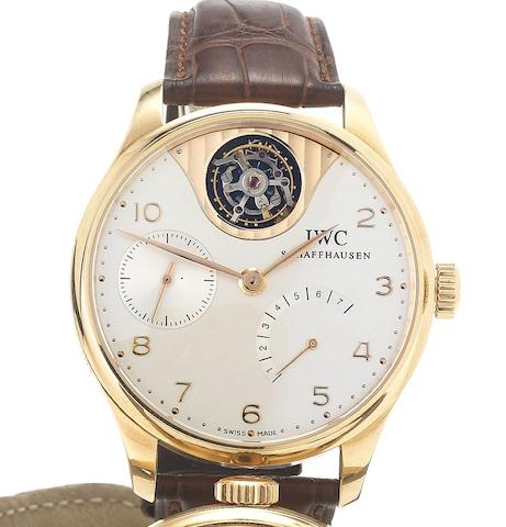 IWC. A fine and rare 18ct rose gold limited edition wristwatch with seven day power reserve and TourbillonPortugese Tourbillon Mystere, No.115/250, Made in 2005