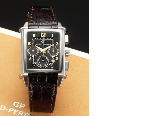 Eberhard & Co. An 18ct gold automatic chronograph calendar wristwatch together with fitted box and papers Extra-Fort, Ref:0809, Case No.30951, Sold January 2nd 2004