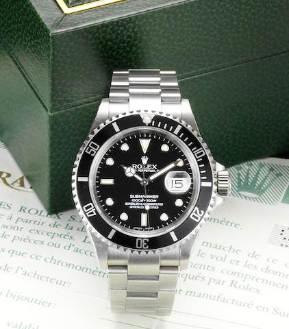 Rolex. A fine stainless steel automatic centre seconds calendar bracelet watch together with fitted box and papers  Submariner, Date, Ref:16570, Sold August 31st 2000