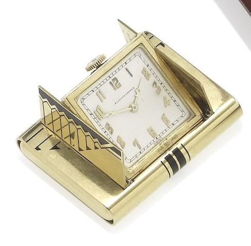 Lacloche Frères. A fine Art Deco 18ct gold purse watchLondon Import Mark for 1928