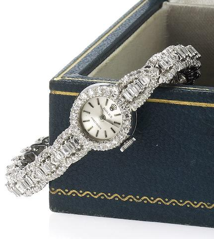 Rolex. A fine 18ct white gold and diamond set ladies cocktail watch with 14ct white gold and diamond set bracelet Ref:2179, 1960's