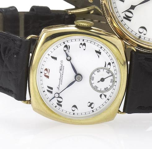 IWC. An early enamel dial 14ct gold cushion cased wristwatch with hinged back Case No. 866638. Movement No.763824, Circa 1920's