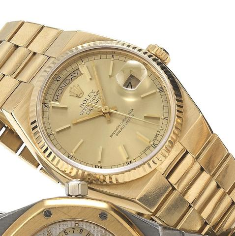 Rolex. A fine 18ct gold quartz centre seconds calendar bracelet watch Oysterquartz, Day-Date, Ref:19000, Circa 1979