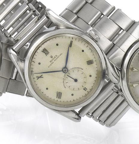 Rolex. A fine stainless steel automatic wristwatch with sweep centre seconds and fancy lugsRef:5018/5016, Bombé, Case No.641740, Movement No.35936 and N98593, circa 1958