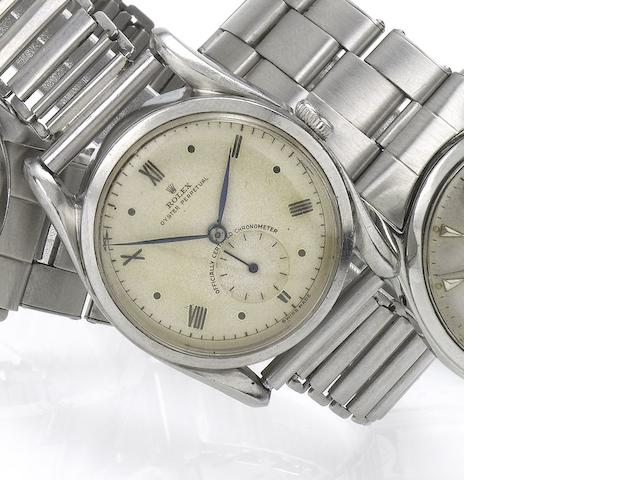 Rolex. A fine stainless steel automatic wristwatch with sweep centre seconds and fancy lugs Ref:5018/5016, Bombé, Case No.641740, Movement No.35936 and N98593, circa 1958