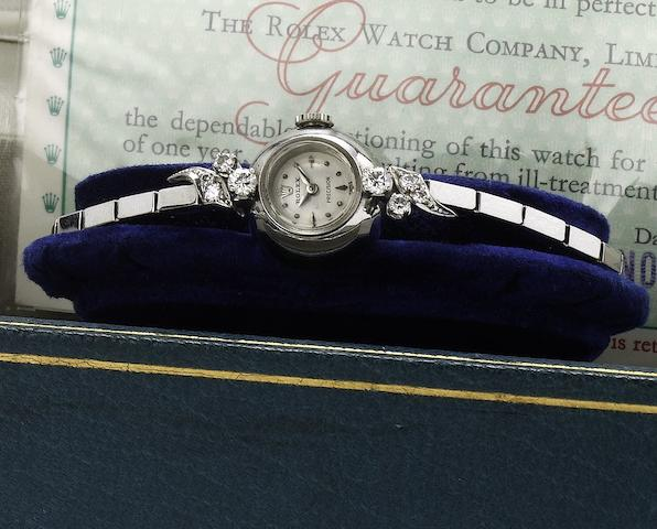 Rolex. A fine lady's 18ct white gold diamond set cocktail watch together with original fitted box Ref:9469, Case No.349851, 1950's