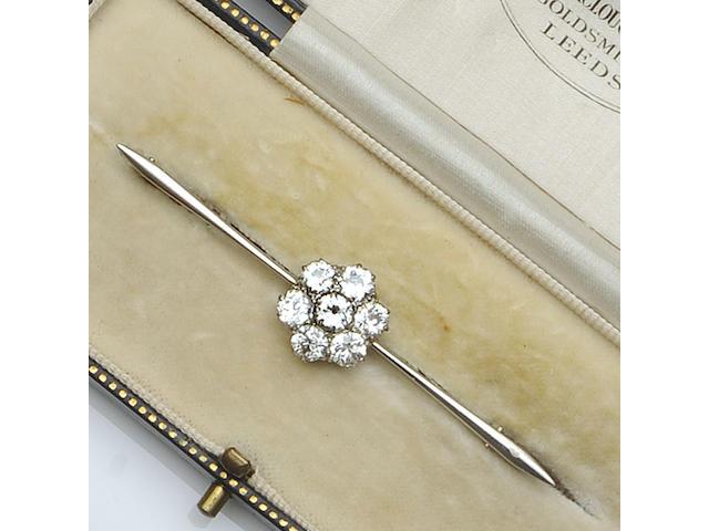A diamond cluster bar brooch