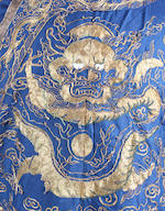 A blue silk Chinese dragon robe, with gilt thread embroidery