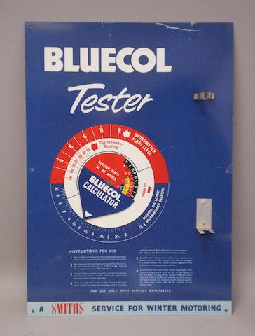 An advertising sign for Bluecol Anti-freeze,