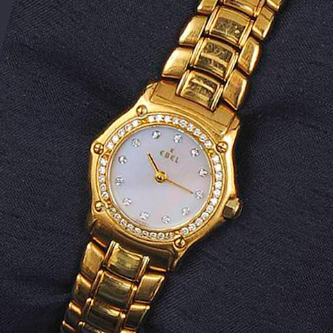 Ebel: A lady's 18ct gold and diamond wristwatch