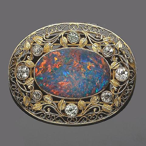 A black opal and diamond brooch