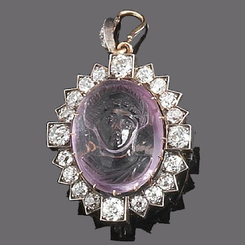 An amethyst and diamond brooch/pendant,