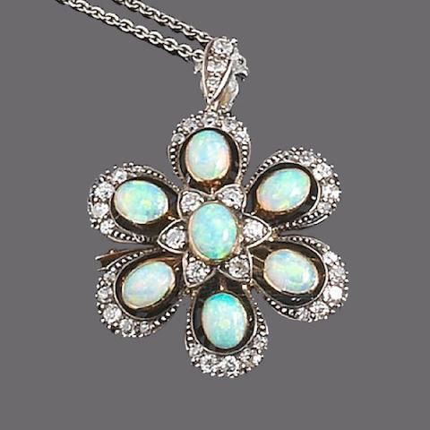 An opal and diamond brooch/pendant,