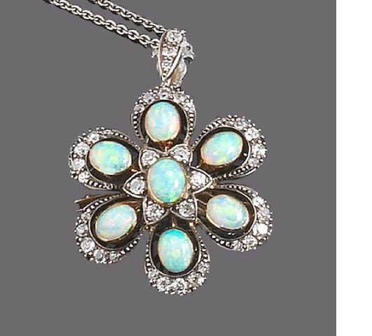 An opal and diamond brooch/pendant,