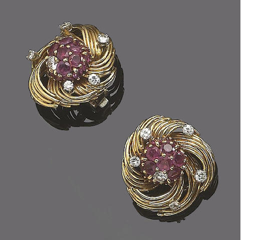A pair of ruby and diamond earclips, by Kutchinsky,