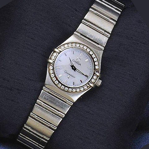 Omega: A lady's diamond set stainless steel Constellation wristwatch
