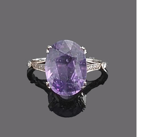 A purple sapphire and diamond ring,