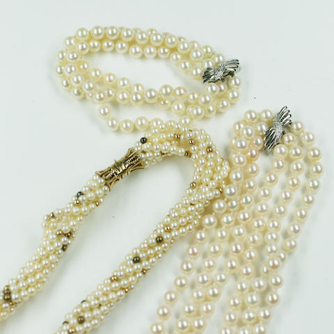 A three row cultured pearl necklace and bracelet suite and a multi strand cultured pearl torsade necklace