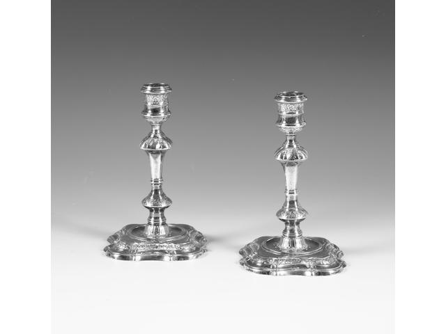 A pair of George II silver cast candlesticks By William Cafe, London, 1739-40,  (2)