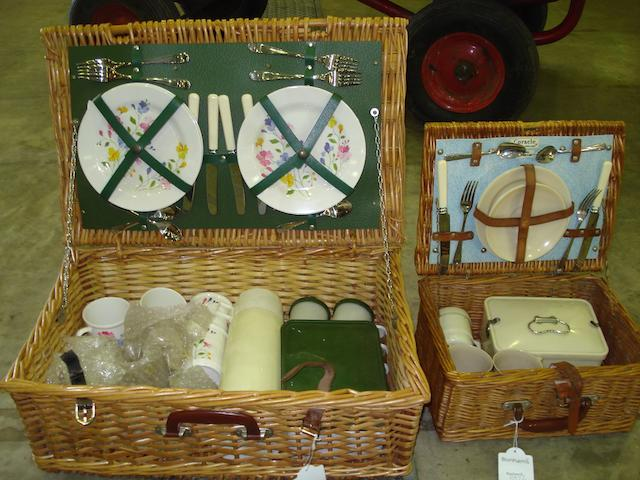 A wicker picnic set with Army & Navy suppliers label,