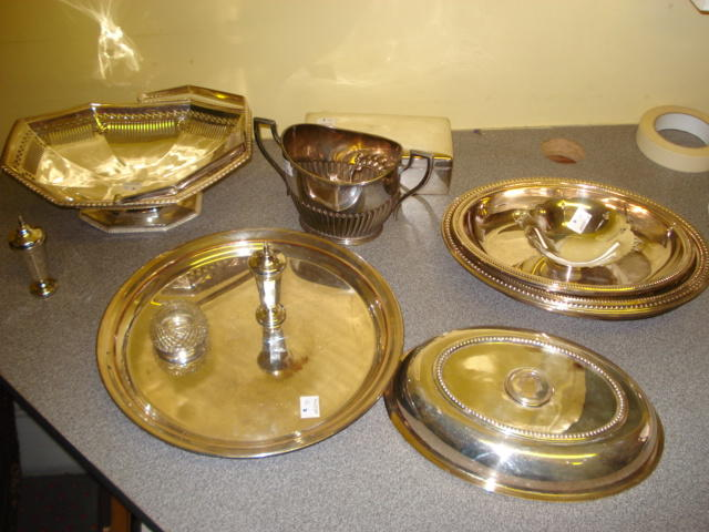 A small twin handled silver pedestal dish, with pierced decoration by Deakin & Francis, Birmingham 1966, a pair of panelled pepperettes 1913, a silver mounted glass salt cellar, a cedar lined cigarette box with panel gilt domed cover, 1916, two plated entree dish covers and handles, pierced cake basket, half gadrooned sugar basin and circular tray.