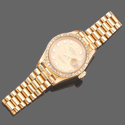 A lady's 18ct gold diamond set automatic calendar bracelet watch, by Rolex