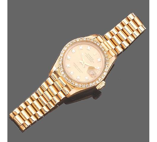 A lady's 18ct gold diamond set automatic calendar bracelet watch, by Rolex