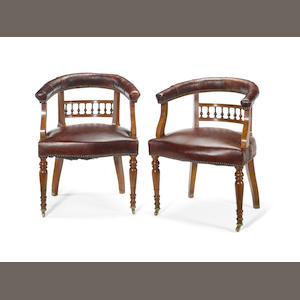A pair of late Victorian mahogany library tub armchairs