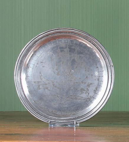 A late 17th Century wrigglework narrow rimmed plate