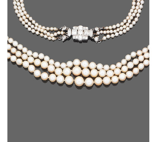 An early 20th century three-strand pearl necklace with diamond clasp, by Cartier