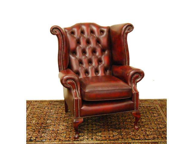 A pair of leather-upholstered wingback armchairs, of recent manufacture