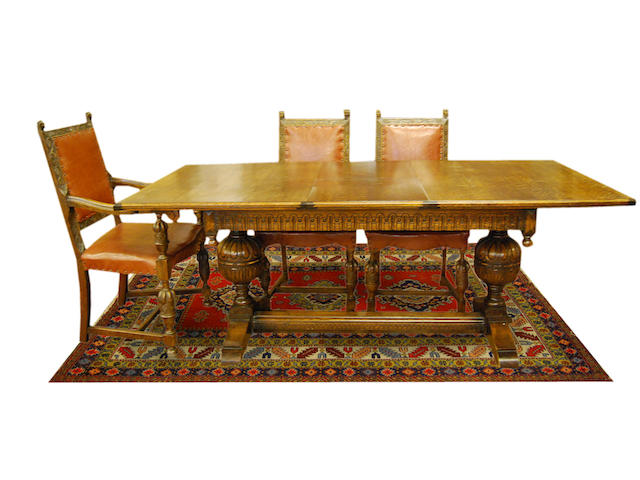 An oak extending refectory-type table and six chairs, early 20th Century The table with ivorine label reading 'The Ee-zi-way One Motion Extending Dining Table'