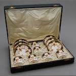 A boxed set of Royal Crown Derby Imari coffee cups and saucers