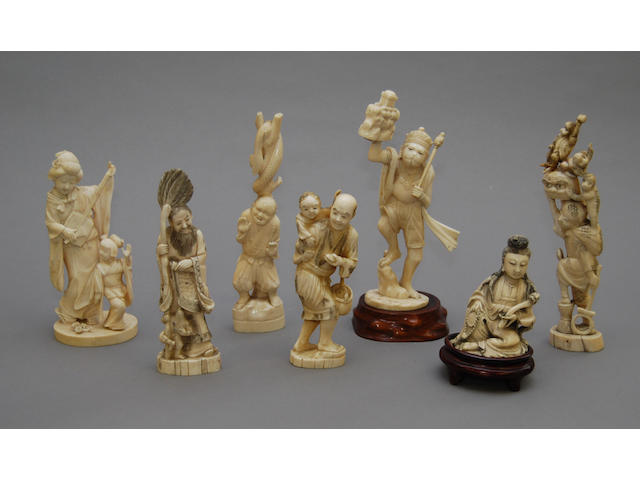 A collection of ivory figures, mainly Japanese